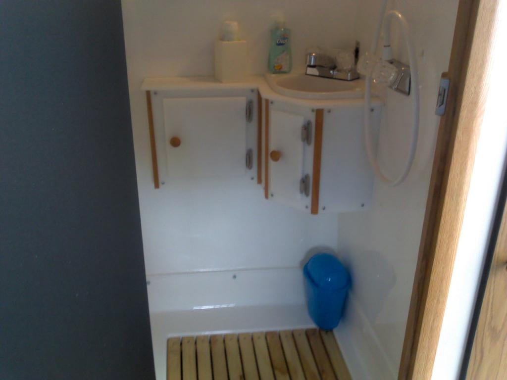 Mods to our 2011 13 39 scamp owners international for Install bathroom in enclosed trailer